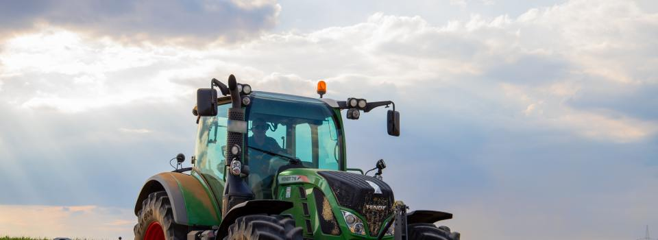 green-tractor-plowing-the-fields-on-focus-photography-2933243