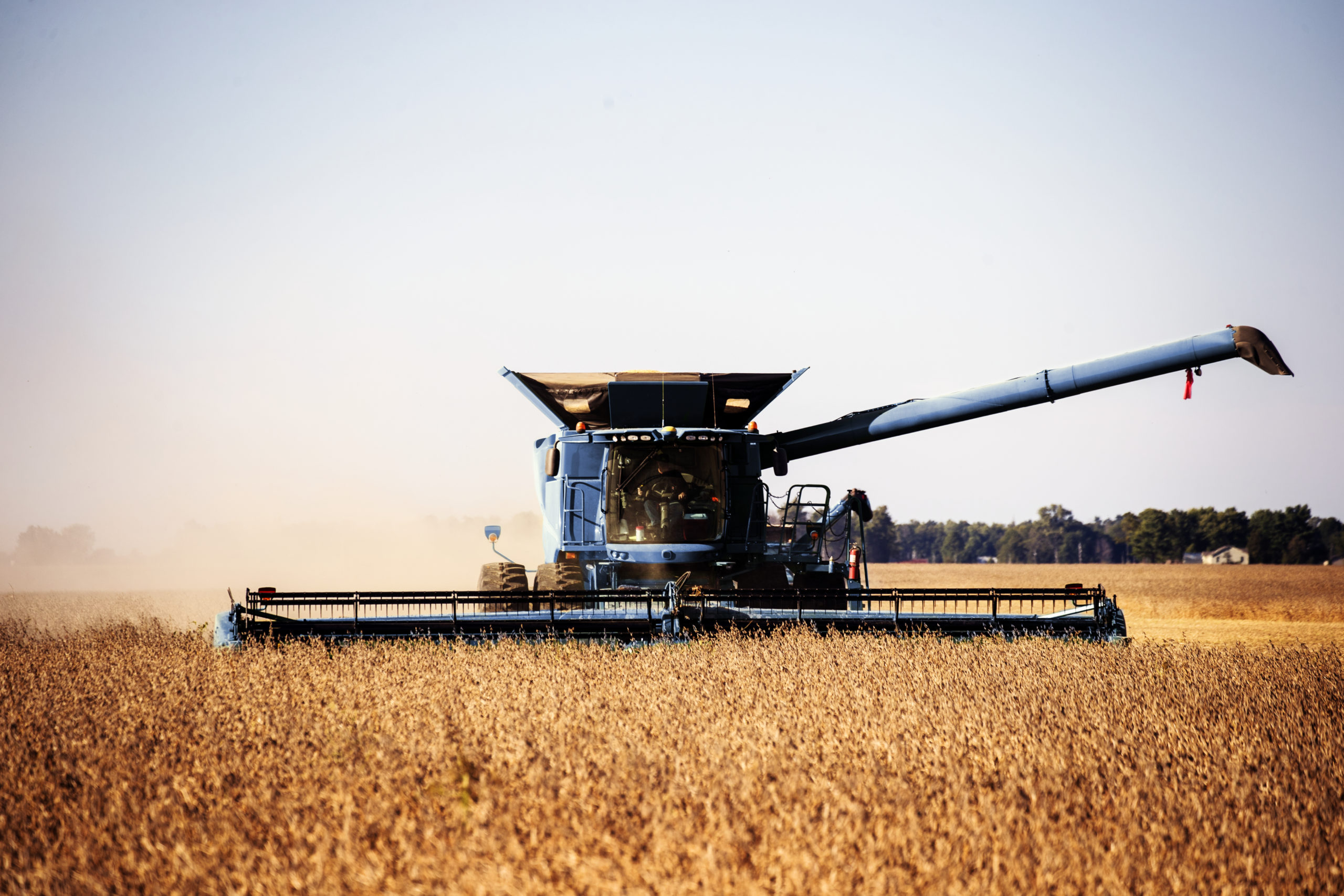 A harvesting operation kicks up dust in rural Carroll County, Indiana. Original image from Carol M. Highsmith's America, Library of Congress collection. Digitally enhanced by rawpixel.